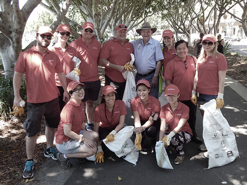 Atradius staff taking part in rubbish clearing day, Australia